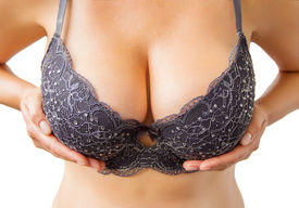 picture of curvy  - Woman holding her big breasts in black bra for a nice cleavage view - JPG