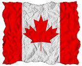 Canada Flag On Wrinkled Paper With Nails