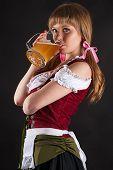 beautiful woman Oktoberfest drinks beer