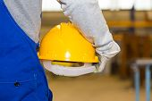 Closeup Of A Hardhat And Construction Laborer