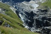 Glacier And Waterfall In Valley Nearby Grindelwald In Alps.