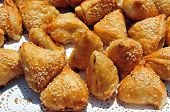 foto of phyllo dough  - Burekas type of baked or fried filled pastry from Turkey - JPG