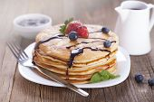 Delicious sweet French pancakes on a plate with fresh fruits
