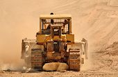 stock photo of bulldozers  - Large bulldozer excavating top soil for later use on a new commercial construction development project - JPG