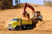 stock photo of excavator  - Track hoe excavator loading a 10 - JPG