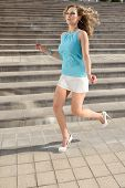 Girl In Light Blue Dress Running
