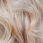 Wavy blonde woman hair background and texture