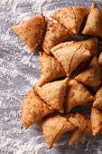 Indian Samosa Pastry On A Floured Table. Vertical Top View