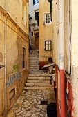Narrow street in Greek town.