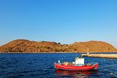 The red boat in the blue lagoon.