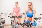 stock photo of exercise bike  - Cycling on exercise bikes - JPG