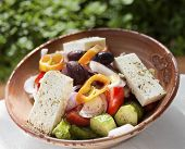 stock photo of greek food  - Greek salad with feta cheese tomato and cocumber - JPG