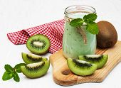 stock photo of smoothies  - kiwi smoothie in glass on a old white wooden background - JPG