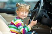 Little girl pretending to drive car
