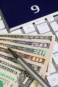 Business Desk - Diary For September,us Dollars,pen And Keyboard