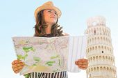 Young Woman With Map In Front Of Leaning Tower Of Pisa, Tuscany,