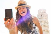 Happy Young Woman Making Selfie In Front Of Leaning Tower Of Pis