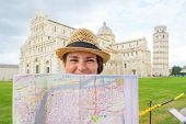 Portrait Of Happy Young Woman With Map On Piazza Dei Miracoli, P