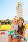 Portrait Of Smiling Mother And Baby Girl With Italian Flag In Fr