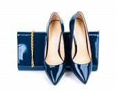 pic of clutch  - Beautiful blue shoes with clutches on white isolated background