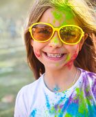 Happy Cute Litttle Girl On Holi Color Festival