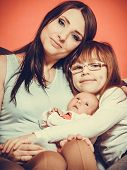 Woman With Daughter And Newborn Baby Child