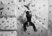 Girl Climbing On Wall Indoor