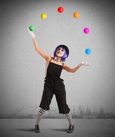 stock photo of clowns  - Clown playing with balls like a juggler - JPG