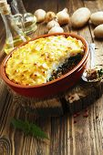 picture of nettle  - Potato casserole with meat and nettle on the table - JPG