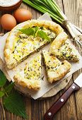 stock photo of nettle  - Pie with nettles and spring onion on the table - JPG
