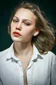 stock photo of thinkers pose  - serious pretty woman portrait on black background - JPG