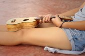 picture of ukulele  - Woman playing ukulele vintage style at the park - JPG