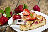 picture of devonshire  - Homemade pie with fresh strawberries on a plate on a wooden table - JPG