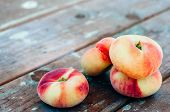 picture of saturn  - Fresh Saturn peaches on old wooden background - JPG
