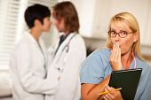 image of office romance  - Alarmed Medical Woman Witnesses Her Colleagues Inner Office Romance Display - JPG