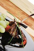 pic of chive  - served ribs over wooden table with chives and grapes - JPG