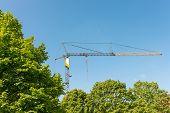 foto of construction crane  - Tower crane on a construction site in Hamburg Altona - JPG