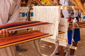 foto of nomads  - A man produces the fabric on a traditional loom in the Bedouin village Egypt - JPG