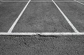 image of parking lot  - Empty place on urban parking lot white marking lines over gray asphalt pavement - JPG