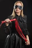 pic of deprivation  - portrait of a girl with red leather whip and mask BDSM - JPG