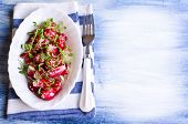 picture of sesame seed  - Salad from a radish with sesame seeds in a white plate - JPG