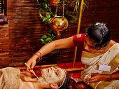 pic of ayurveda  - Woman having clay Indian facial mask at ayurveda spa - JPG