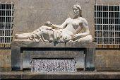 stock photo of turin  - The fountain of Dora river in Turin Italy - JPG