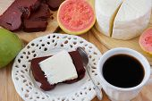 image of juliet  - Brazilian dessert Romeo and Juliet goiabada and Minas cheese with cup of coffee and fresh goiaba on wooden table - JPG