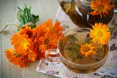 image of marigold  - Herbal tea with marigold flowers on the table - JPG