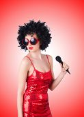 pic of pop star  - Pop star with mic in red dress against the gradient - JPG