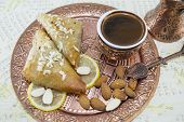 picture of baklava  - Turkish coffee baklava and almonds on an engraved copper plate - JPG