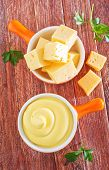 pic of shredded cheese  - cheese sauce in bowl and on a table - JPG