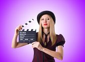 picture of gangster  - Woman gangster with movie board against the gradient - JPG