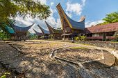 foto of traditional  - Row of traditional houses and rice barns facing each other in a tipical traditional village of Tana Toraja South Sulawesi Indonesia - JPG